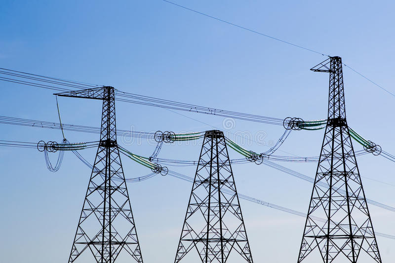 Download Power Line Poles Over Blue Sky Background Royalty Free Stock Image - Image: 10763276