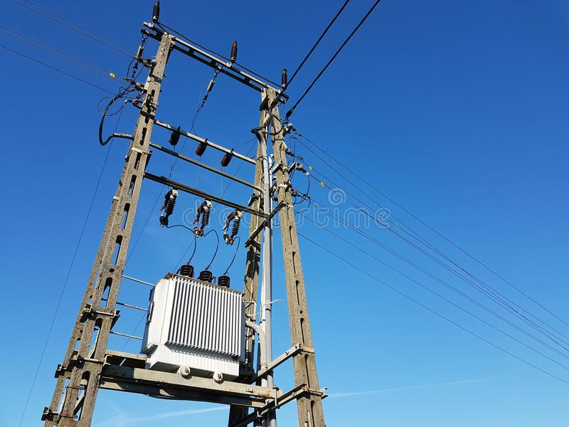 Power Line Post Against A Blue Sky With A Trace From A Jet Aircraft ...