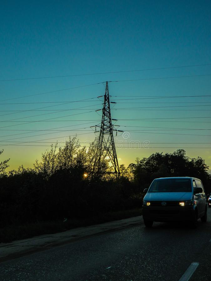 Power line at sunset. The sunset illuminates the landscape is beautiful and varied colors. Urban types of modern highways and cities also look very nice, and royalty free stock photos