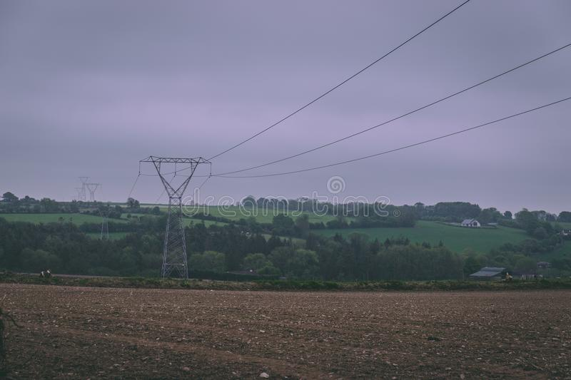 Power line towers and cables in the Irish countryside stock photos
