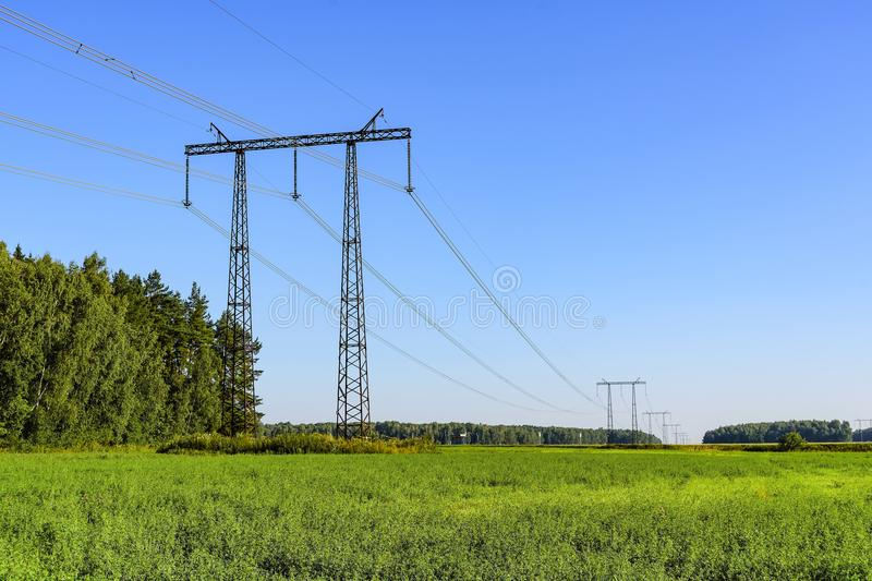 Power line transmission of electrical energy on high-voltage metal structures royalty free stock photography