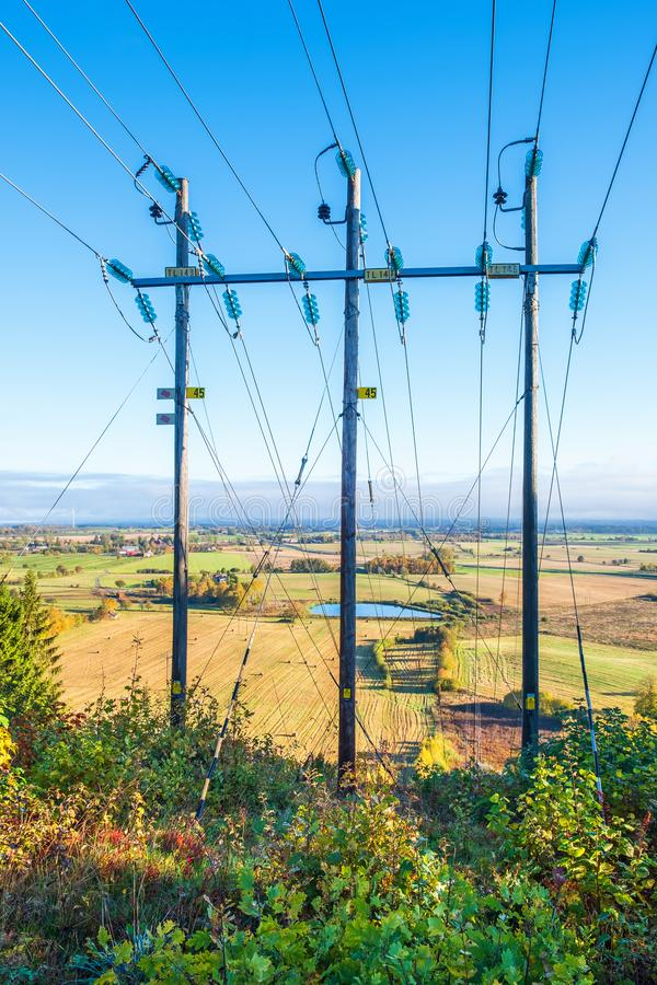 Power line with a view over the fields with autumn colors royalty free stock photography