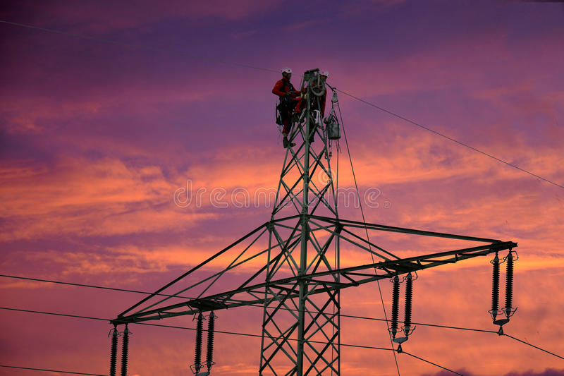 Power line workers stock photos