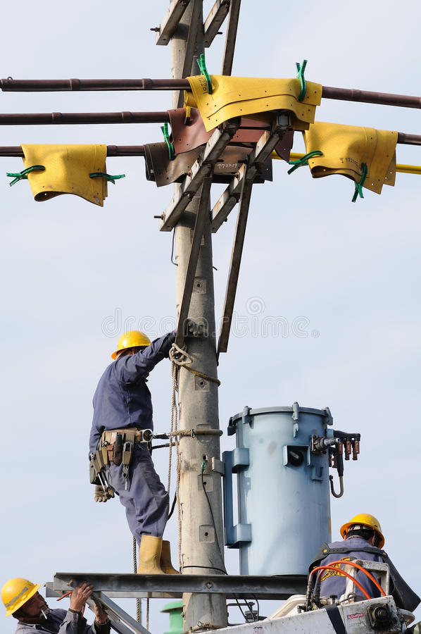 Power Lineman Working Together in Taiwan royalty free stock photography