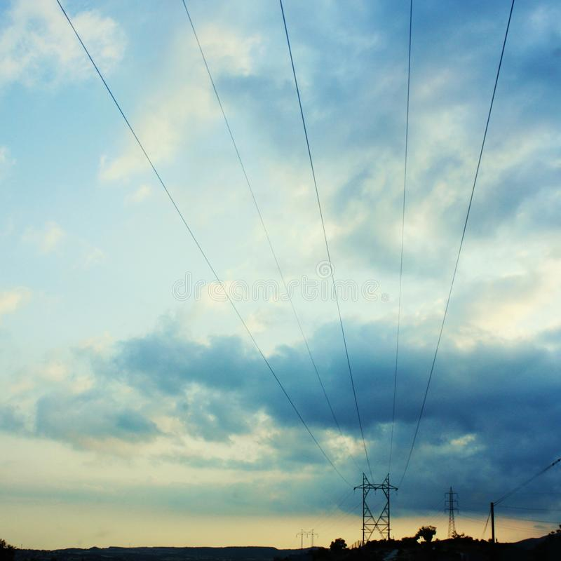 Power lines. Dividing the sky above royalty free stock photo