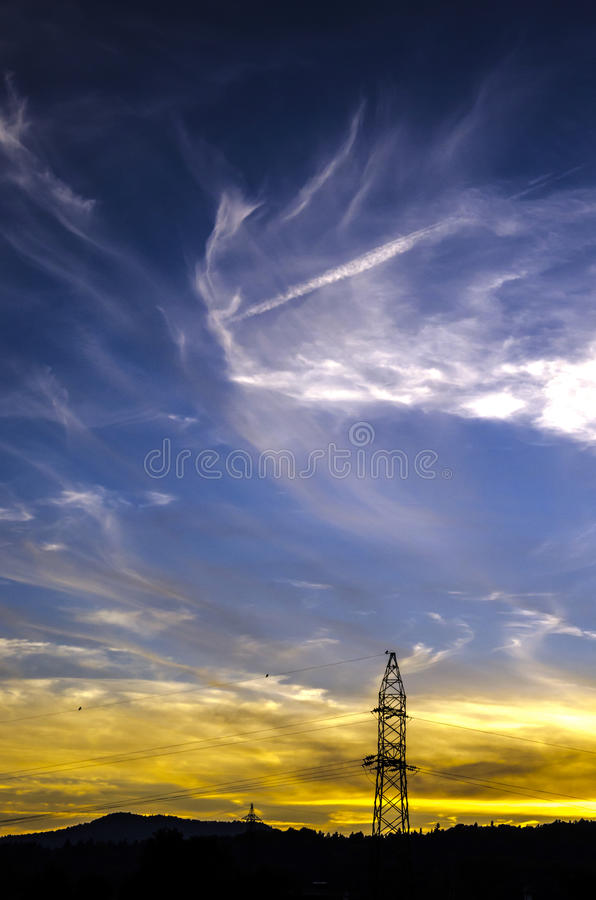 Power lines. In a beautiful sunset environment stock photography