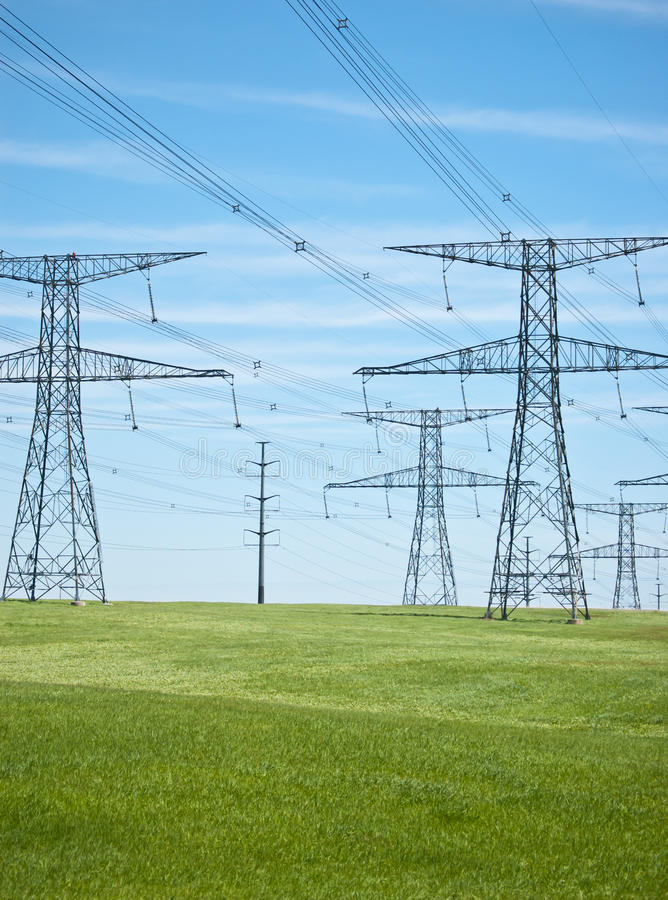 Download Power Lines With Blue Sky And Green Grass Stock Photo - Image: 18373848
