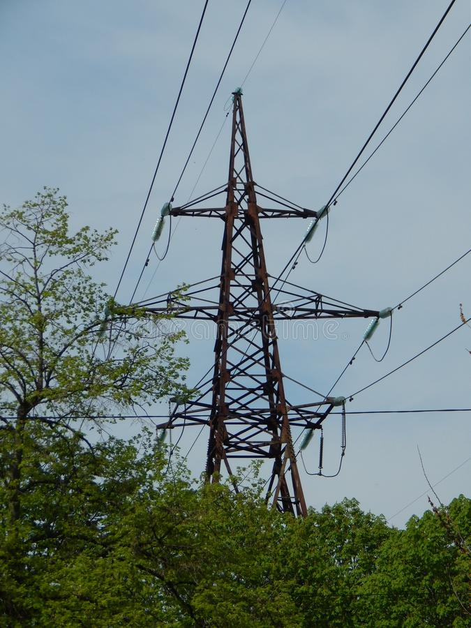 Power lines in the city, strained wires on a metal structure. Power lines in the city, strained wires on a metal stock image