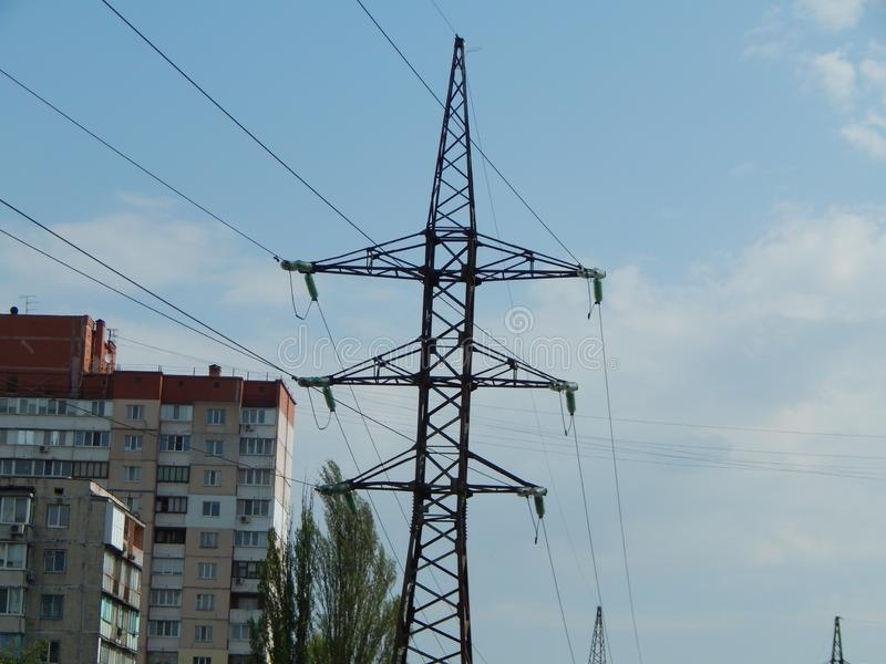 Power lines in the city, strained wires on a metal structure. Power lines in the city, strained wires on a metal stock photos