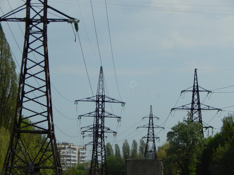 Power lines in the city, strained wires on a metal structure. Power lines in the city, strained wires on a metal royalty free stock photos