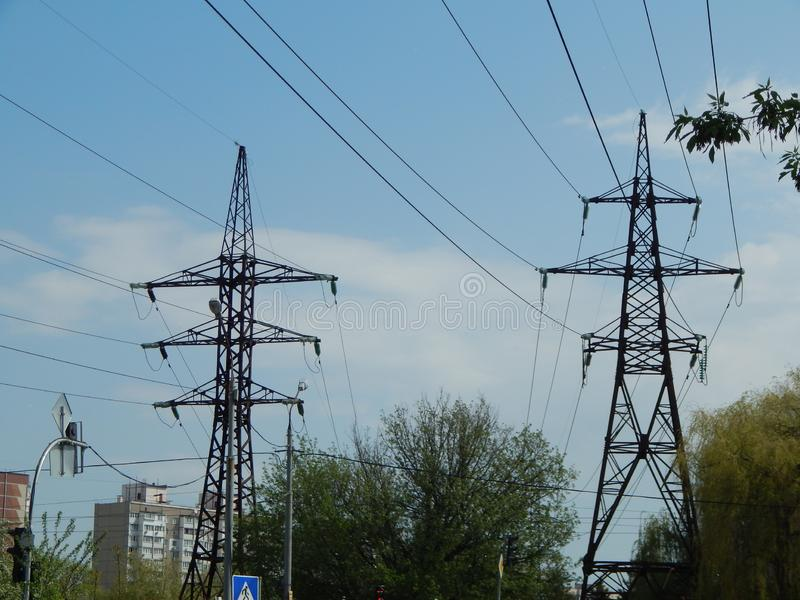Power lines in the city, strained wires on a metal structure. Power lines in the city, strained wires on a metal stock photo
