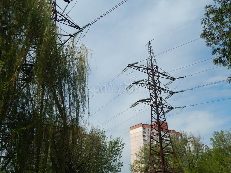 Power lines in the city, strained wires on a metal structure. Power lines in the city, strained wires on a metal stock images