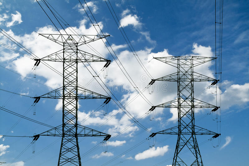 Power lines and electric pylons. The blue sky Power lines and electric pylons royalty free stock images
