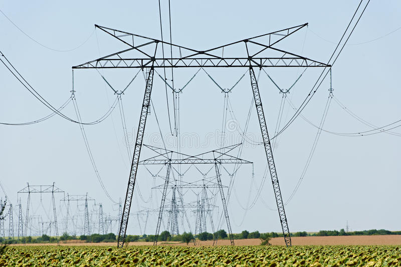 Power lines high voltage stock images