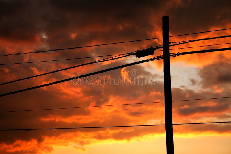 Power lines seen at sunset royalty free stock photos