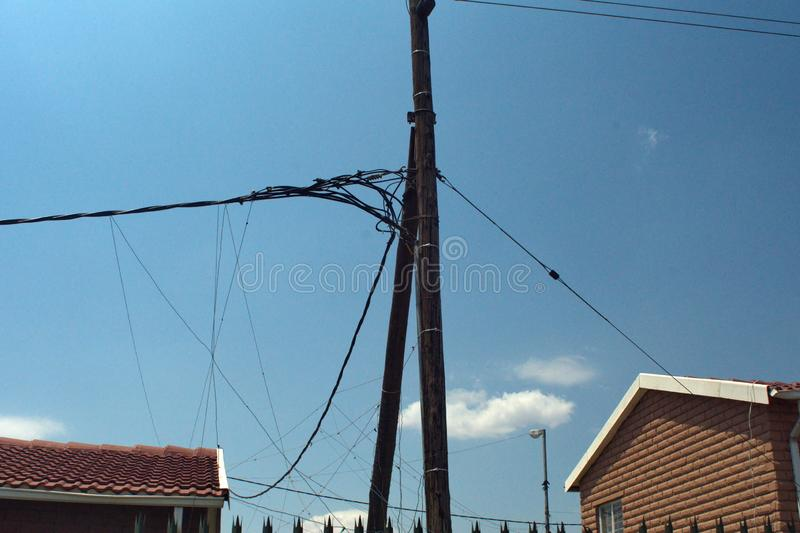 Power lines in Soweto. Power lines with illegal taps in Soweto, south of Johannesburg, South Africa royalty free stock image