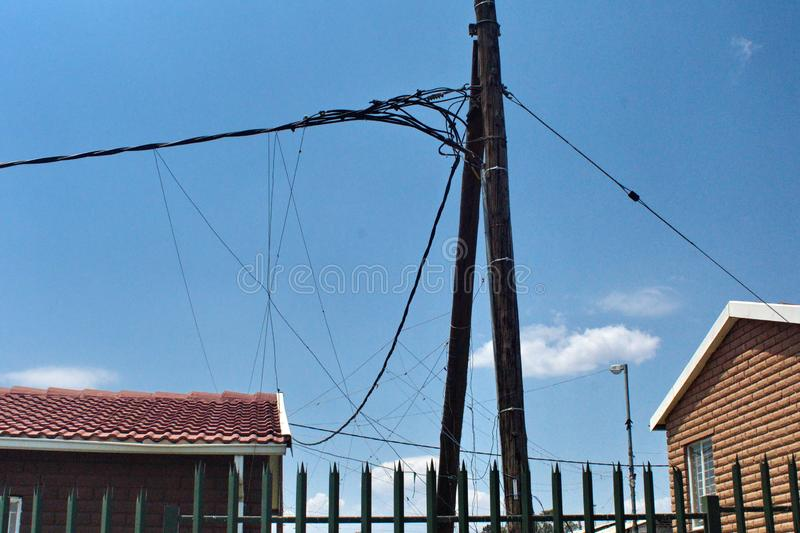 Power lines in Soweto. Power lines with illegal taps in Soweto, south of Johannesburg, South Africa stock image