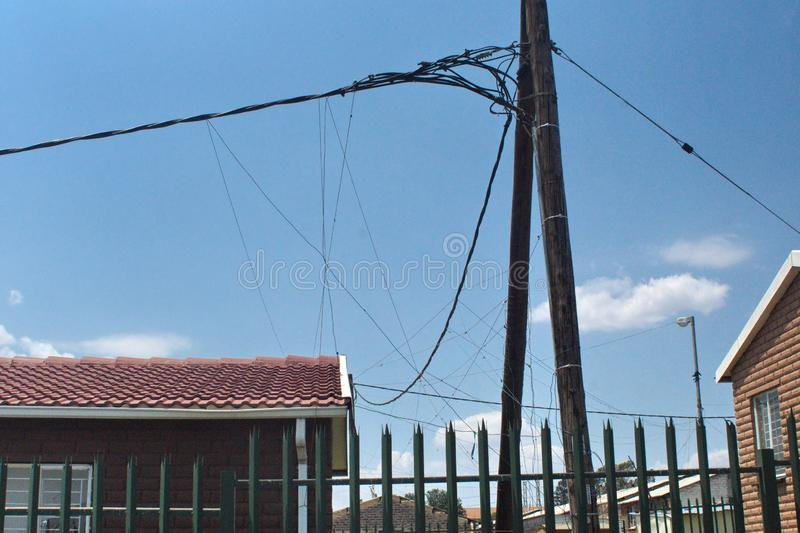 Power lines in Soweto. Power lines with illegal taps in Soweto, south of Johannesburg, South Africa royalty free stock images