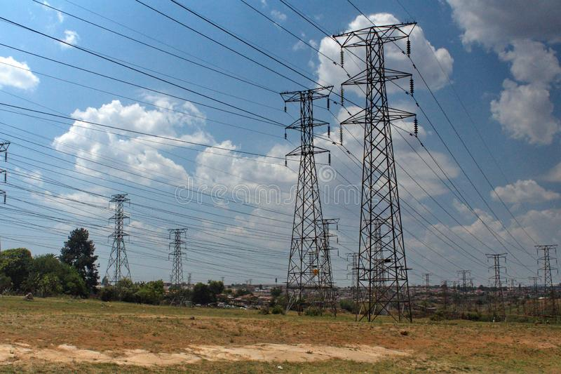 Power lines in Soweto. Power lines running through Soweto, the township south of Johannesburg, South Africa stock image
