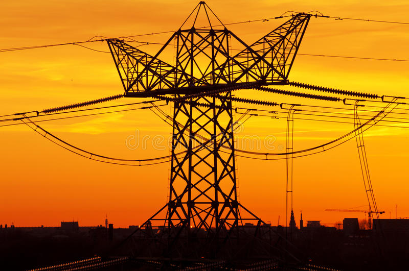Power lines at sunset. High voltage power lines at sunset royalty free stock image