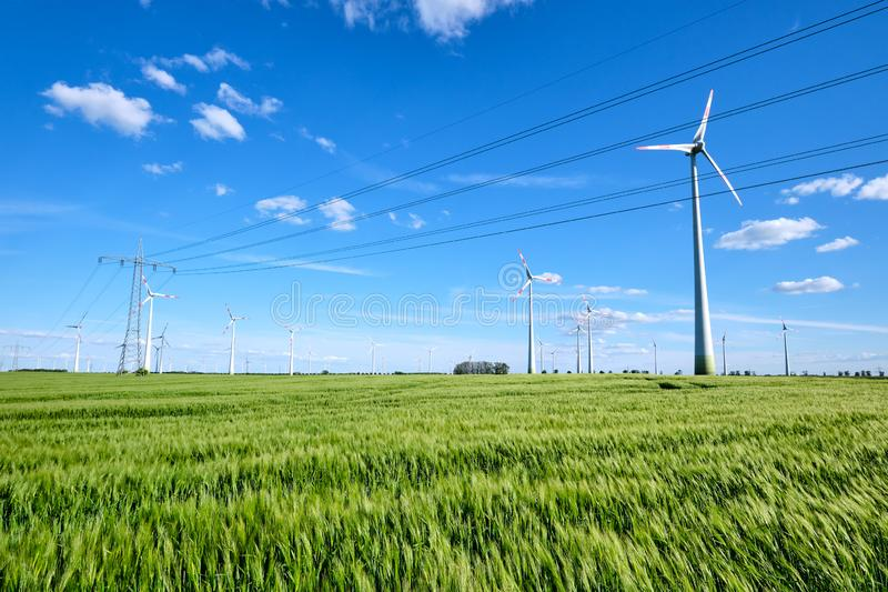 Power lines and wind engines. On a sunny day seen in Germany royalty free stock photography