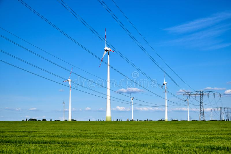 Power lines and wind engines. On a sunny day seen in Germany stock photos