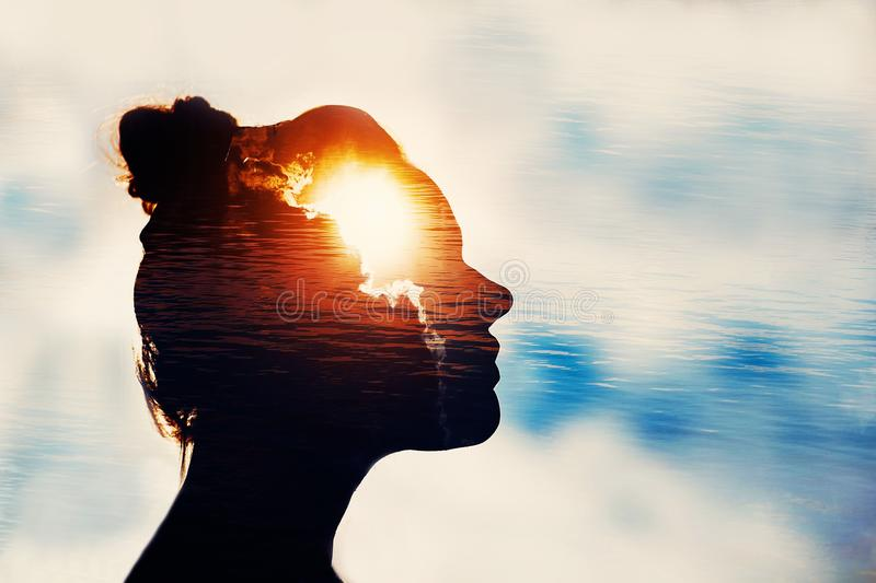 Power of mind concept. Silhouette of smart girl. The Light Head. The concept of the power of knowledge. Psycology and philosophy stock image