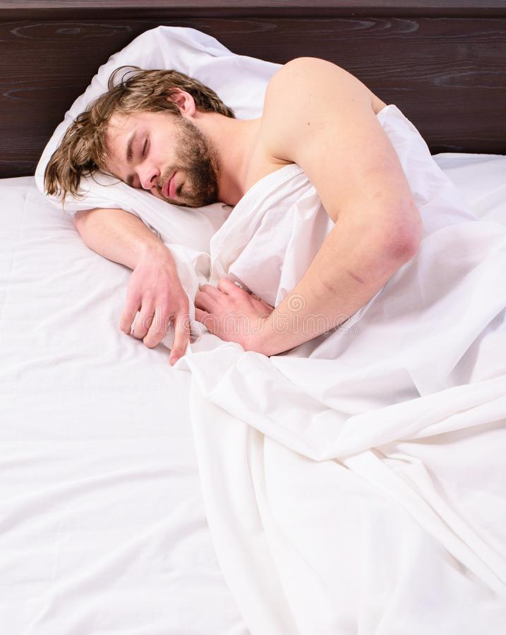 Power napping may help you get through day. Have nap relax. Man sleepy drowsy unshaven bearded face covered blanket. Having nap. Guy lay under white bedclothes royalty free stock photo