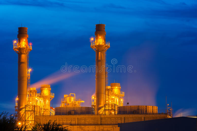 Power plant at dusk with twilight support all factory. Gas turbine electrical power plant at dusk with twilight support all factory stock photos