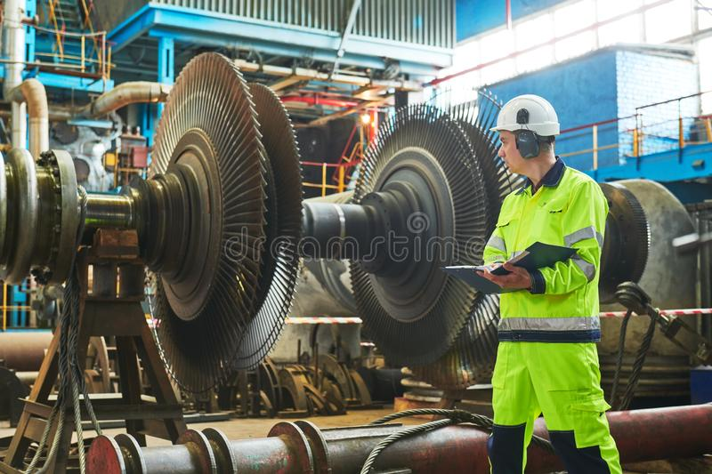 Power plant maintenance. Industial worker stock photography