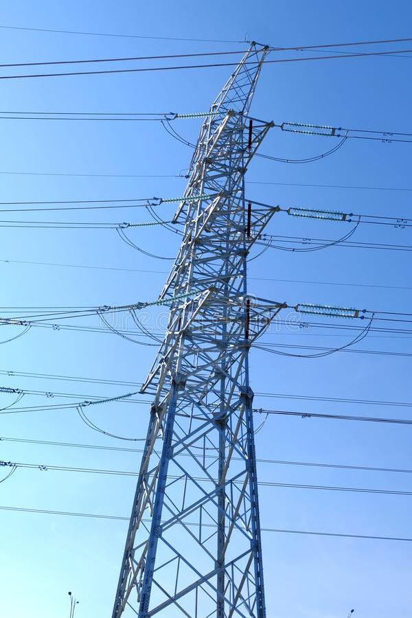 High power transmission towers. The power plant must raise the voltage to the high voltage power to carry the electricity in a long distance. The dangerous high royalty free stock image