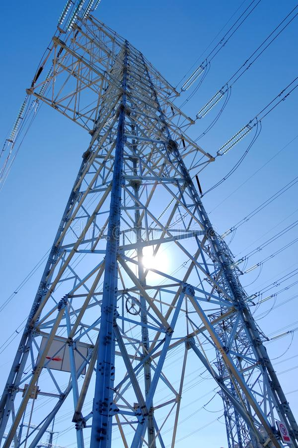 High power transmission towers. The power plant must raise the voltage to the high voltage power to carry the electricity in a long distance. The dangerous high royalty free stock photo