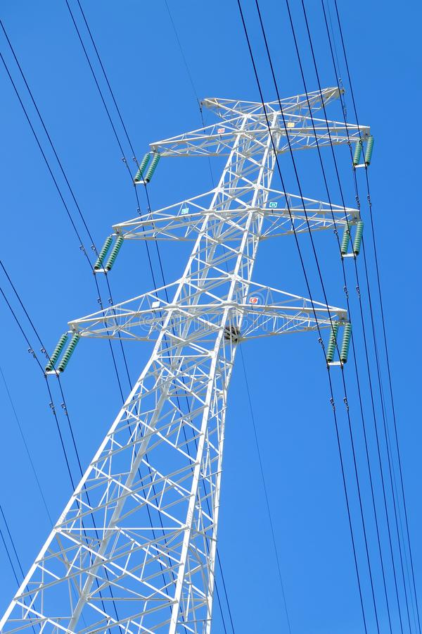 High power transmission towers. The power plant must raise the voltage to the high voltage power to carry the electricity in a long distance. The dangerous high stock photos