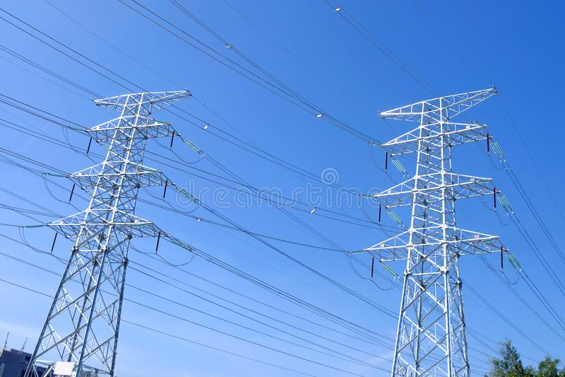High power transmission towers. The power plant must raise the voltage to the high voltage power to carry the electricity in a long distance. The dangerous high stock images
