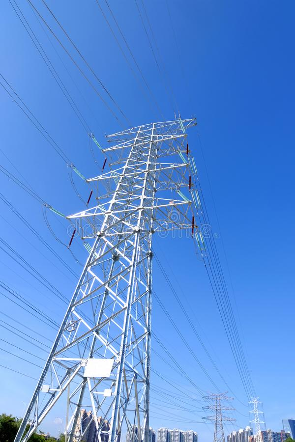 High power transmission towers. The power plant must raise the voltage to the high voltage power to carry the electricity in a long distance. The dangerous high royalty free stock photos