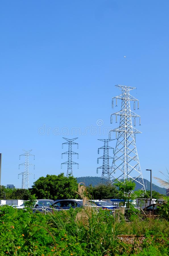 High power transmission towers. The power plant must raise the voltage to the high voltage power to carry the electricity in a long distance. The dangerous high royalty free stock images