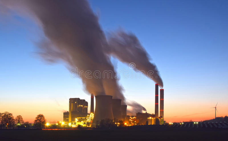 Power plant, photovoltaic panels and wind turbines royalty free stock images