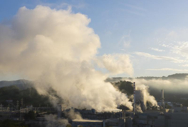 Power plant, Pipes throwing smoke in the atmosphere. In Hernani royalty free stock photos