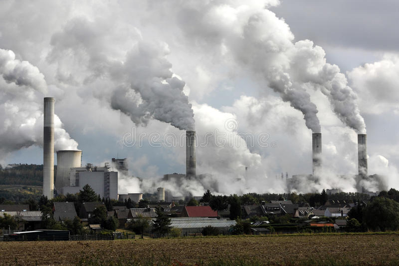 Power plant smoke stacks. Smoking chimneys at the Frimmersdorf power plant in Germany stock images
