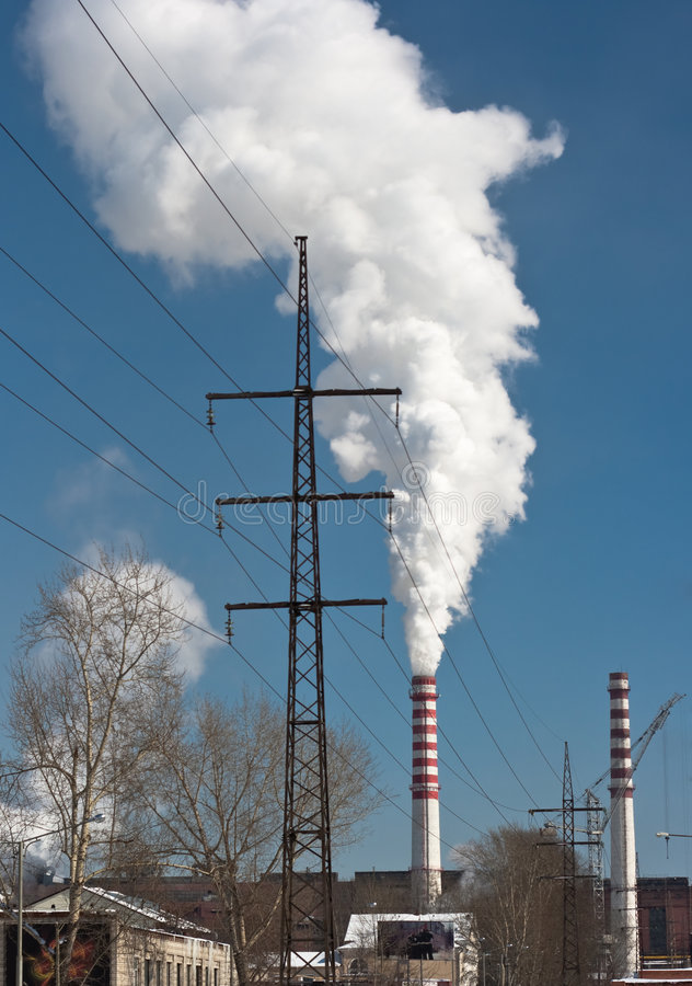 Power plant smoking stacks and tower stock photography