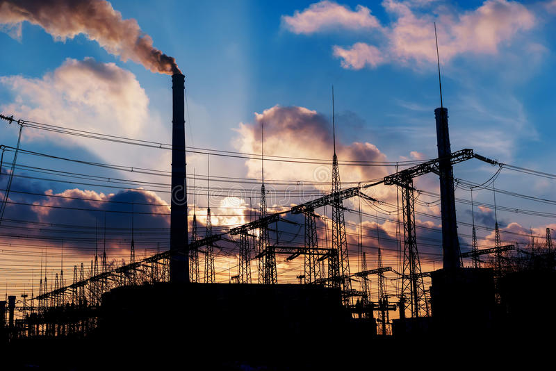 Power Plant during sunrise. Environmental pollution. Factory pipe polluting air. Power Plant during sunrise. Environmental pollution. Factory pipe polluting air royalty free stock photos