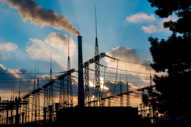 Power Plant during sunrise. Environmental pollution. Factory pipe polluting air. Power Plant during sunrise. Environmental pollution. Factory pipe polluting air royalty free stock photography