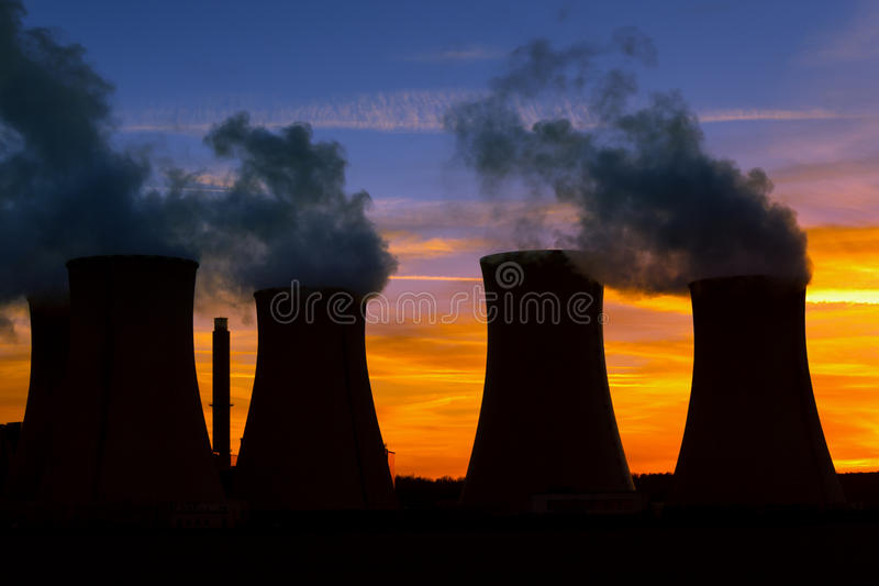 Power plant at sunset royalty free stock photos