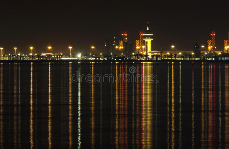 Power plants in Bahrain & reflection on sea stock photography