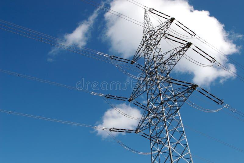 Power Pole with cloud. A Power pole with a blue sky backgound and a cloud stock photos