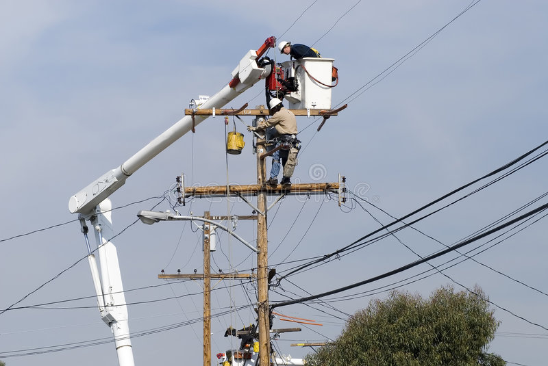 Power pole worker. Men working on a transformer on a electricity power pole stock images