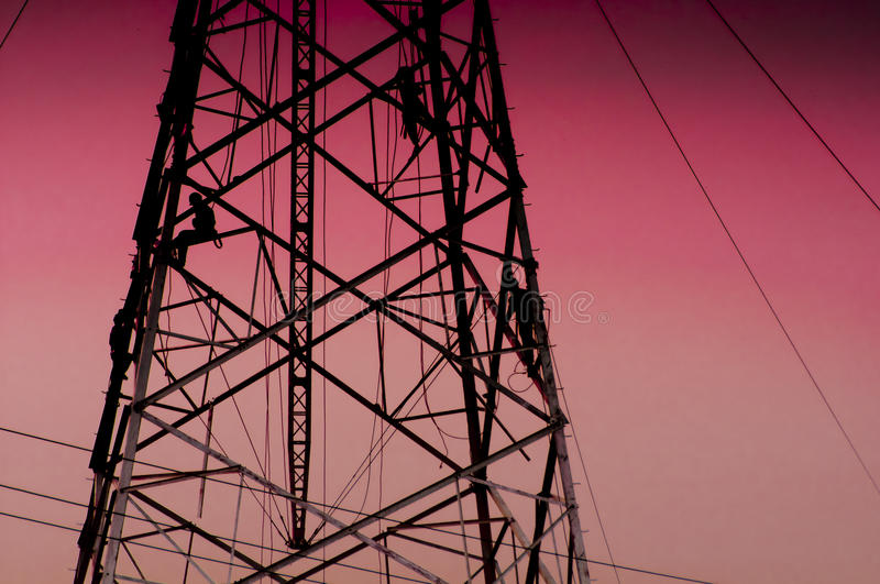Power poles. In the blue sky stock image