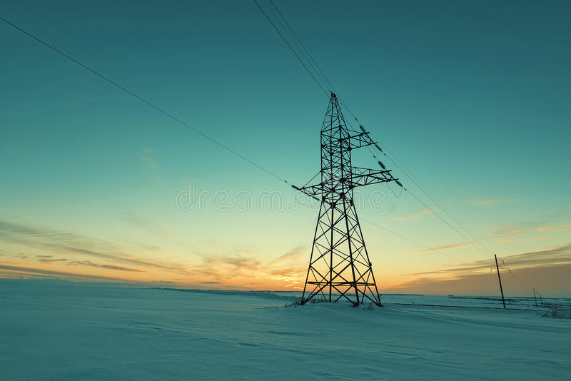 Power poles in the field royalty free stock image