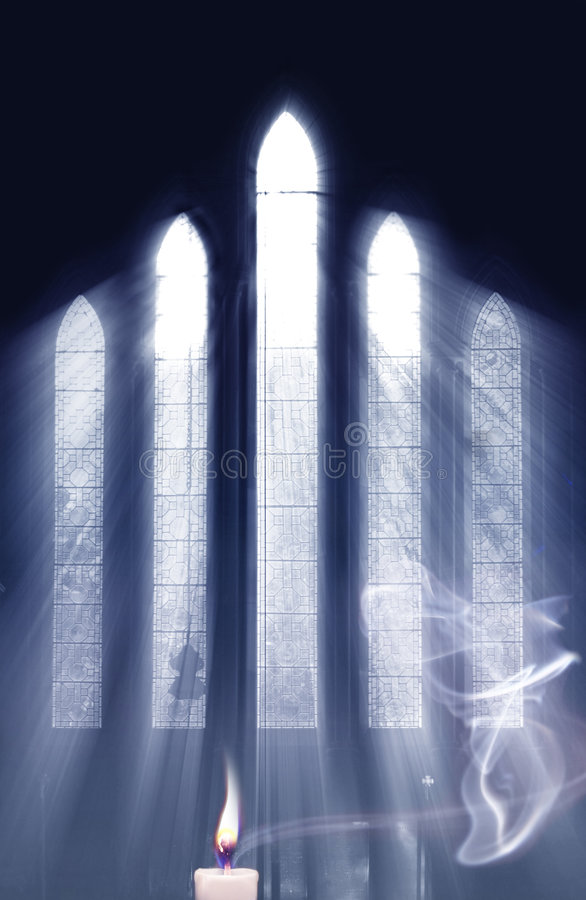 The Power Of Prayer. Concept for seeing the light and the power of Prayer, as light streams through Church window onto cross and highlights smoke from Prayer
