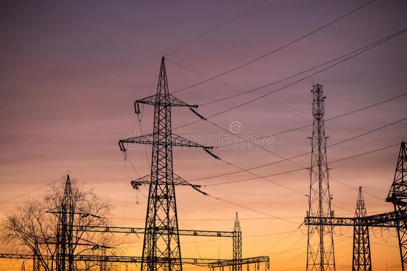 Power pylons sunrise stock photo